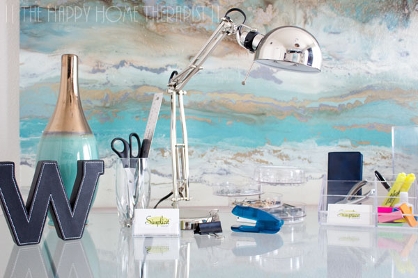 Stylish cups and clear home office organizers are an attractive way to store common desktop supplies! | The Happy Home Therapist